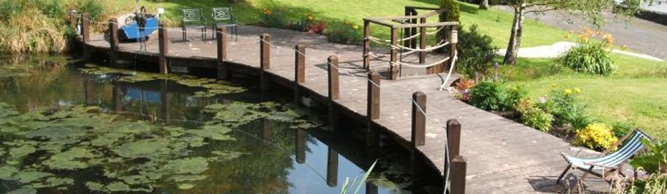 Fencing isle of man jd landscapes ltd decking grass for Wet garden designs